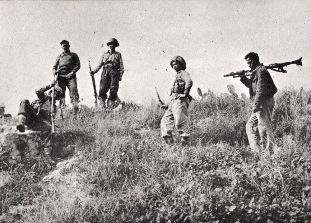 Members of the advance attack group prepare for battle on the hill opposite the monastery