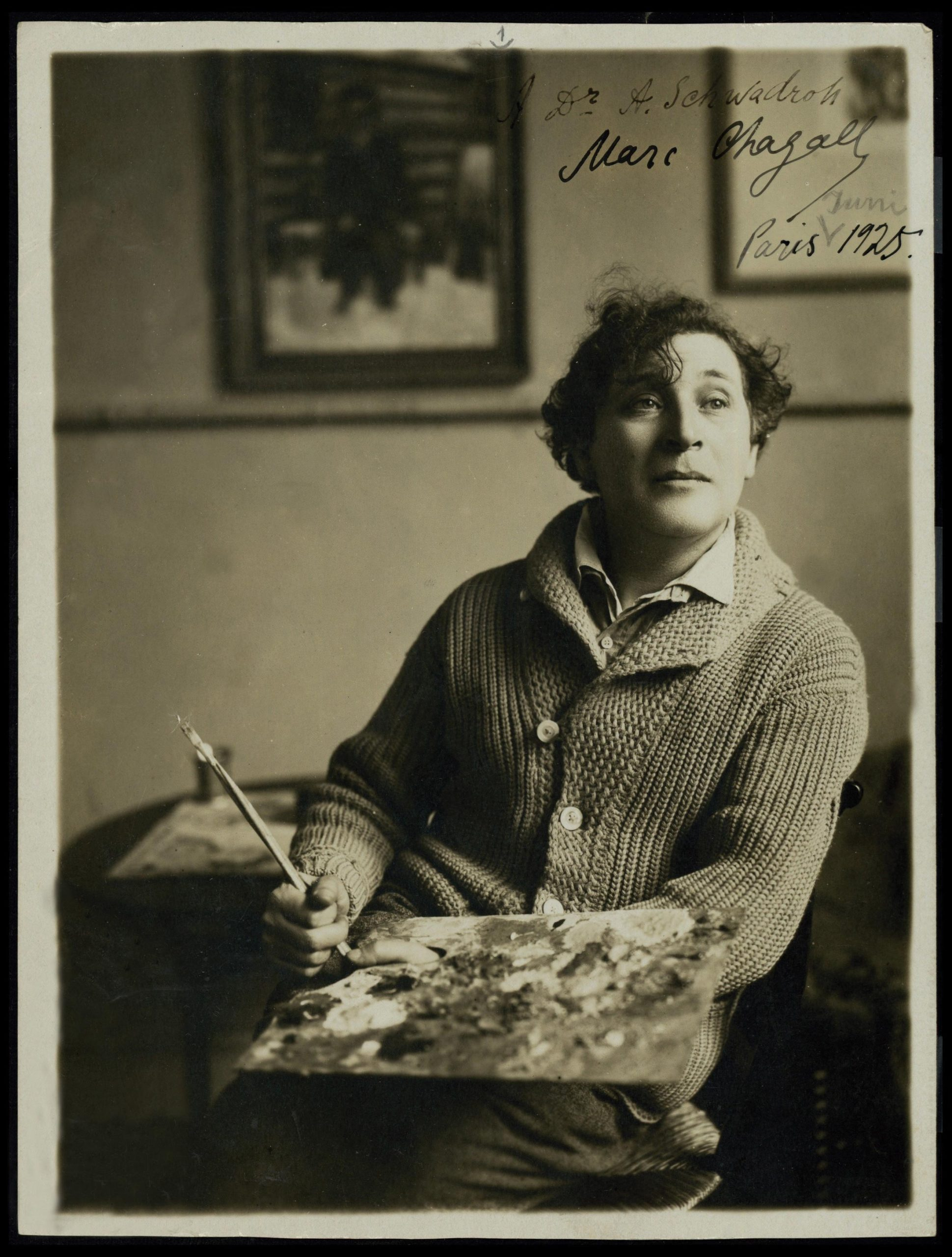 Drawn by the Surrealistic school of art developing in Paris as much as by the city's bright lights and culture. Marc Chagall in the 1920s, at work in Paris