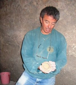 Archaeologist Ian Stern, above, holding a small jug