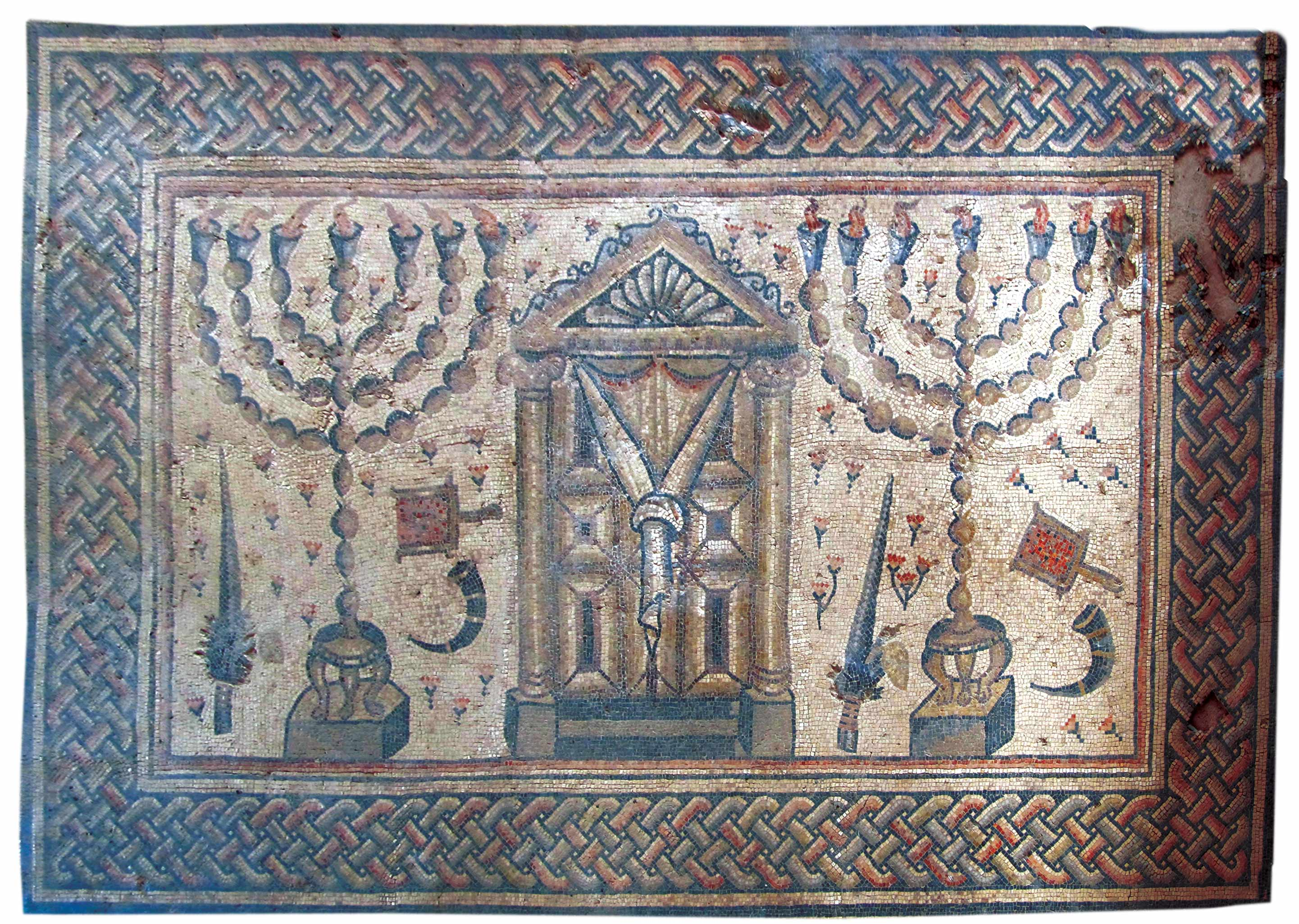 Shofars figure prominently in ancient synagogue mosaics. In this fragment from Hamat Tiberias, found in 1921 and dated to the third or fourth century, two shofars appear among the four species, seven-branched menoras, and coal pans surrounding what may represent the Temple façade