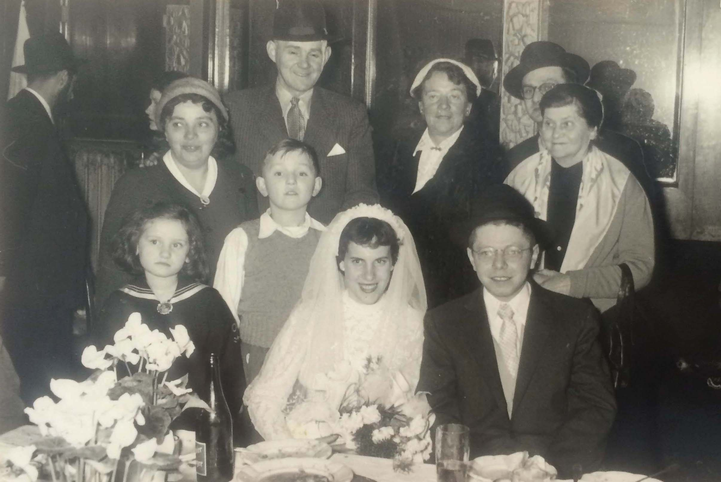 Safely in Vienna. Andor Platschek and his bride (seated) celebrate their wedding, with Piroska, Jeno, and Paul Lindenblatt in the background together with members of the bride's family