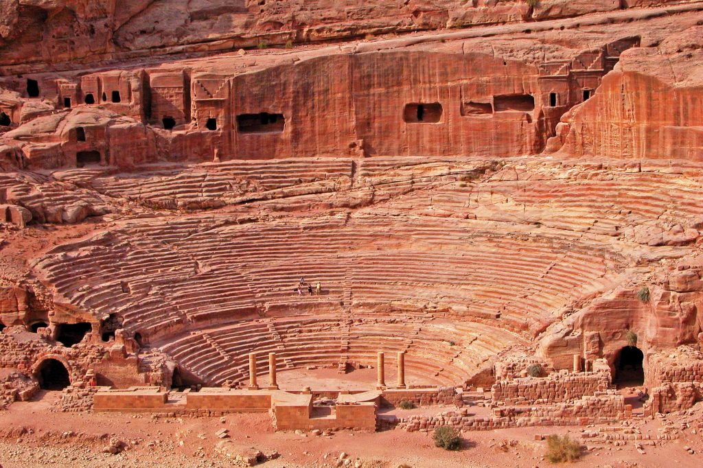 The classical Greek style of Petra's theater – built under Roman rule – indicates outside influences, but the local red stone makes the structure unique