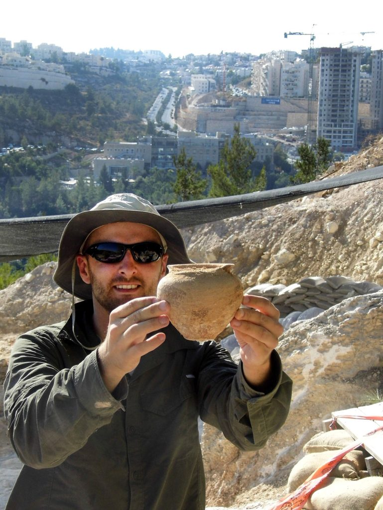 Alex Wigman presents a bowl removed from the ancient tomb