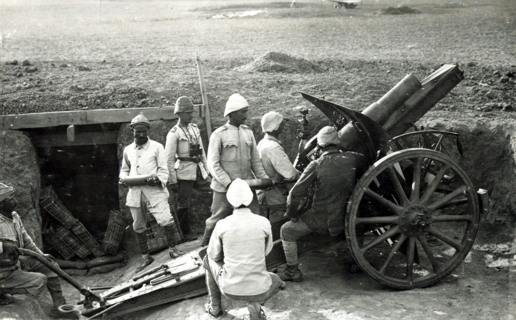 Turkish gunners manning a 105mm German Howitzer, one of many heavy artillery weapons that claimed numerous British lives in the three attacks on Gaza