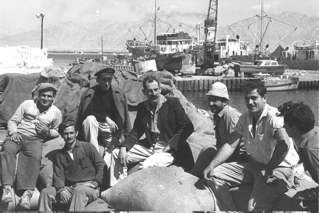 Stevedores take a break in Eilat's old port, 1960