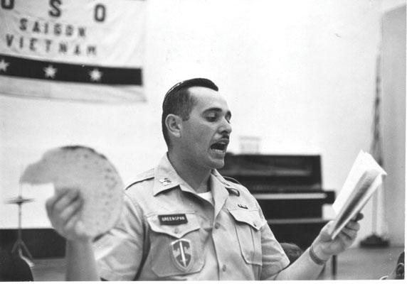 On active matza duty. Chaplain Alan Greenspan with matza in Saigon, April 1966