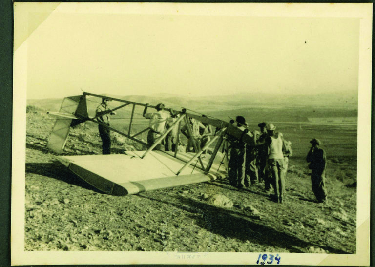 Members of the Israel Flight Club with an overturned glider at Kfar Ha-yeladim, near Afula, 1934