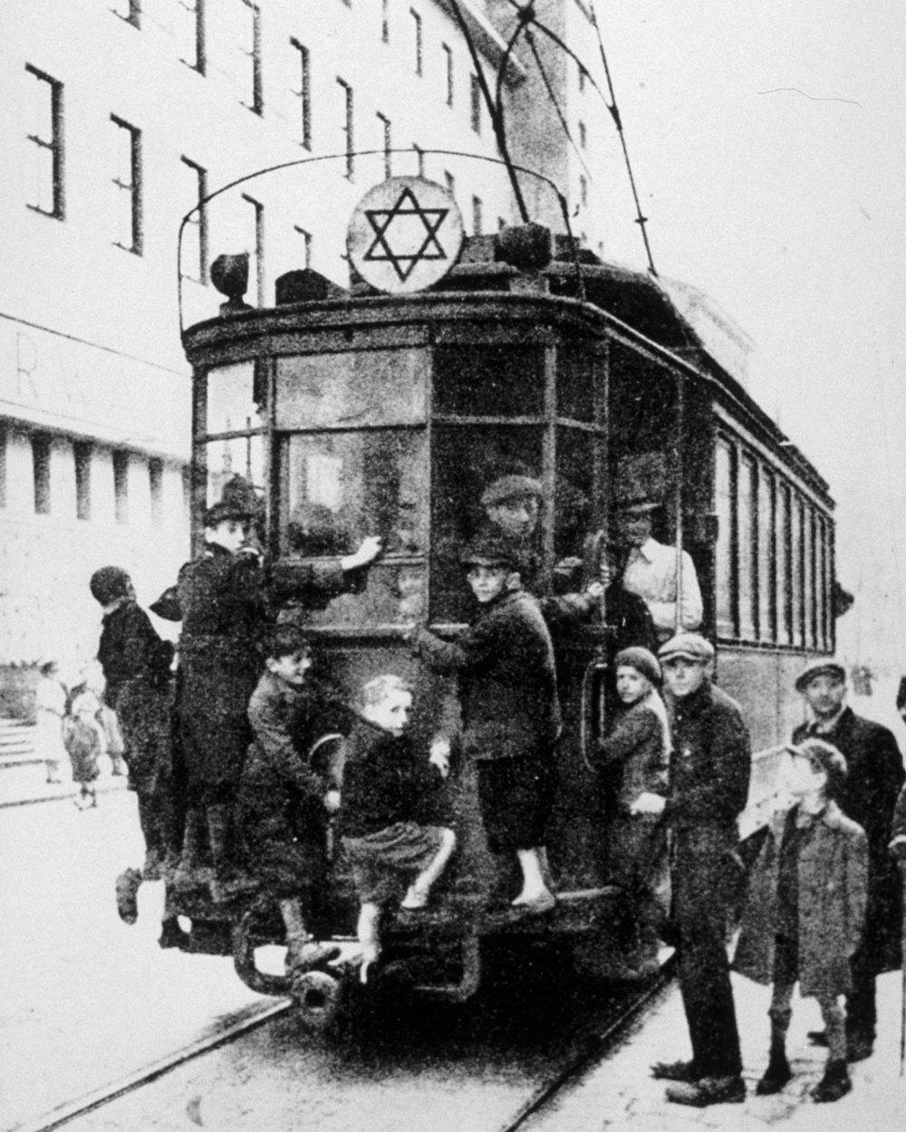 Rabbi Kalonymus Kalmish Shapira, the Piaseczno Rebbe, exhorted Jews to remain observant even in the harsh conditions of the ghetto. Jewish children grab a tram-ride in the Warsaw ghetto, 1940