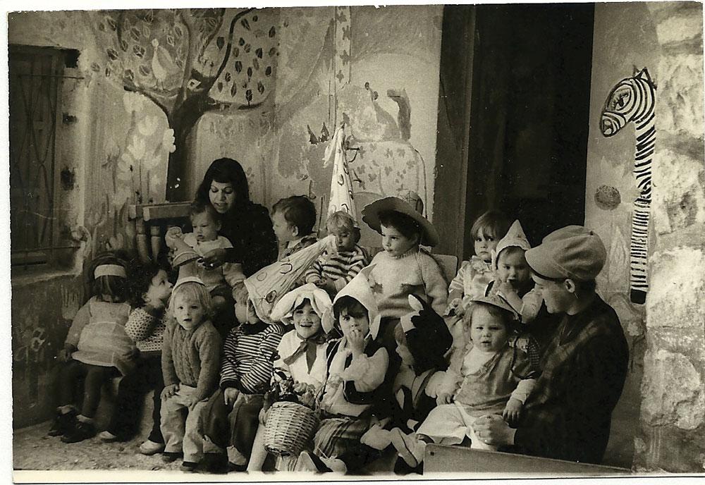 Children play in the kindergarten opened in the Moria clubroom