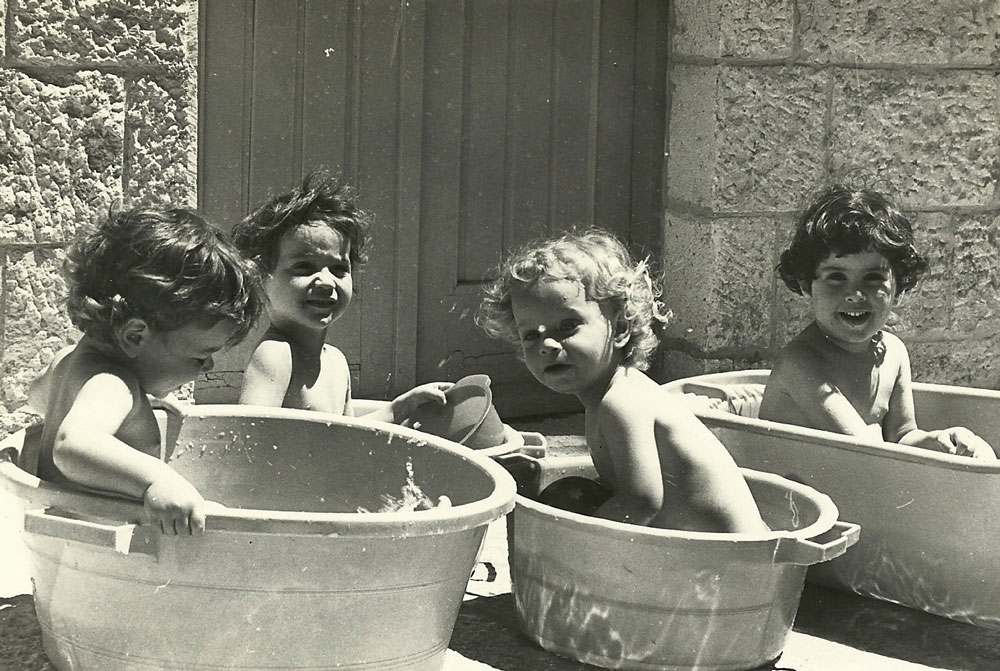 Another prophecy was fulfilled as Jewish children played and laughed in the streets of Zion. Ganat kids cool off on a hot summer's day
