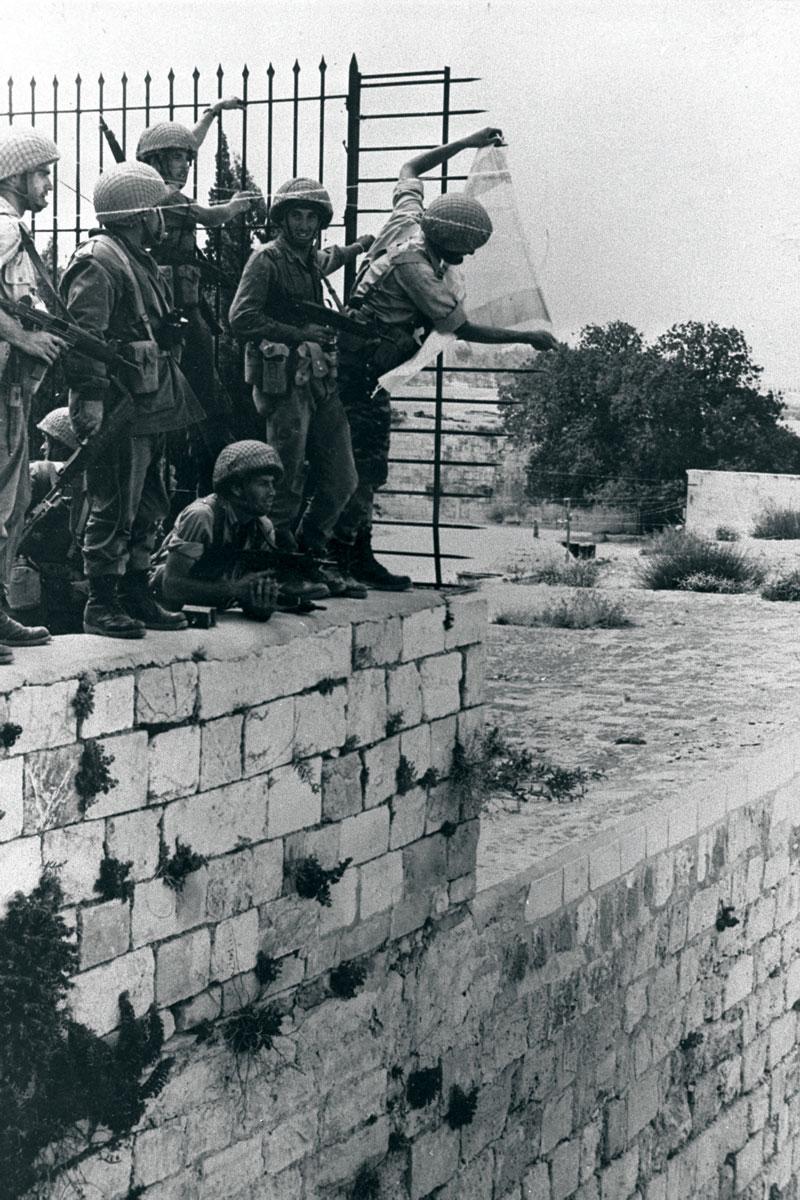 Uplifting moments. Yoram Zamosh and comrades hang the Israeli flag over the Western Wall