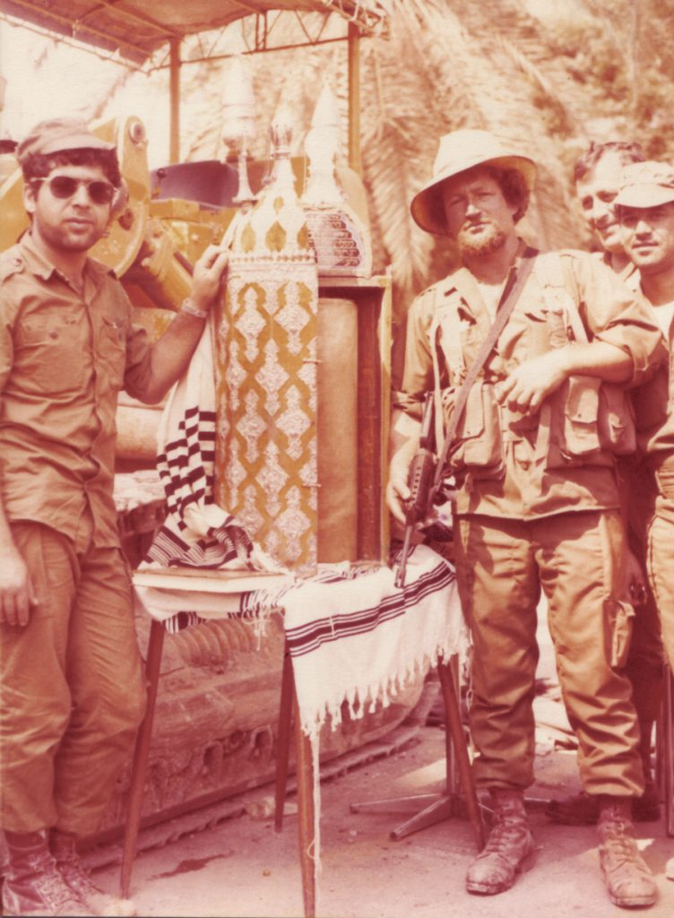 A sacred moment. Two paratroopers with the ancient Torah scroll, Sidon 1982