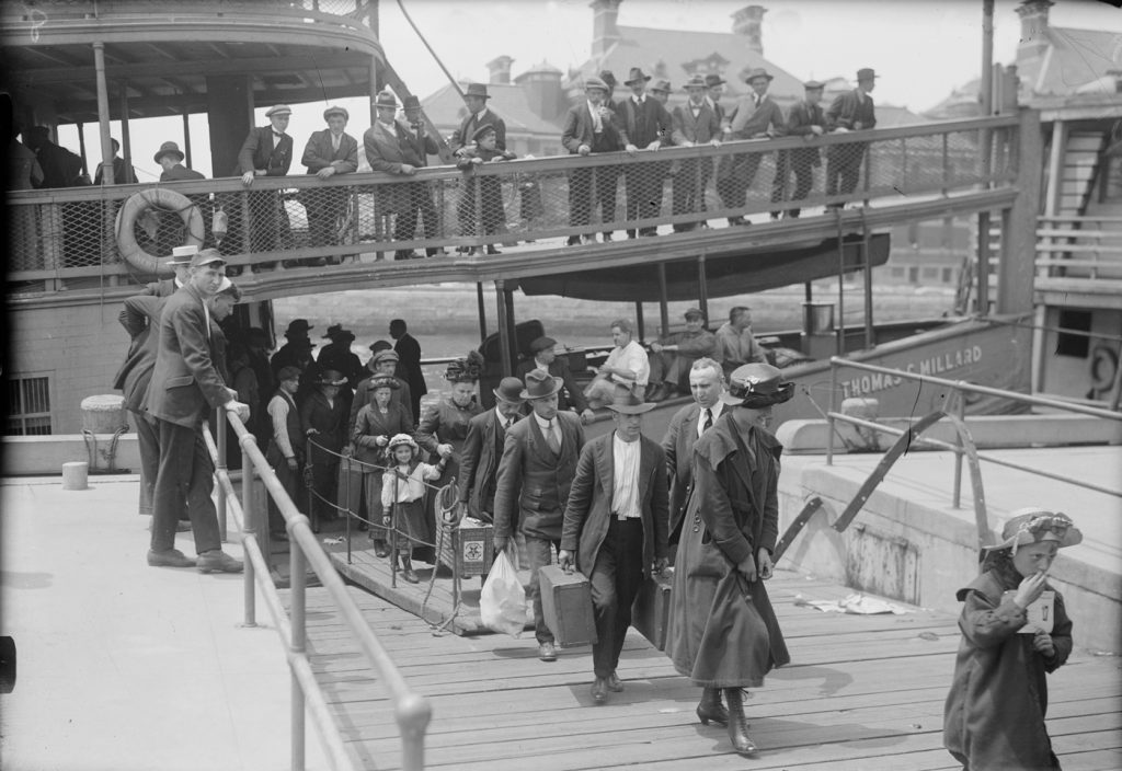 Jews arriving in the land of opportunity – as Gershwin's parents did – aimed to integrate as fully and quickly as possible. Immigrants disembarking at the immigration center on New York's Ellis Island, circa 1920