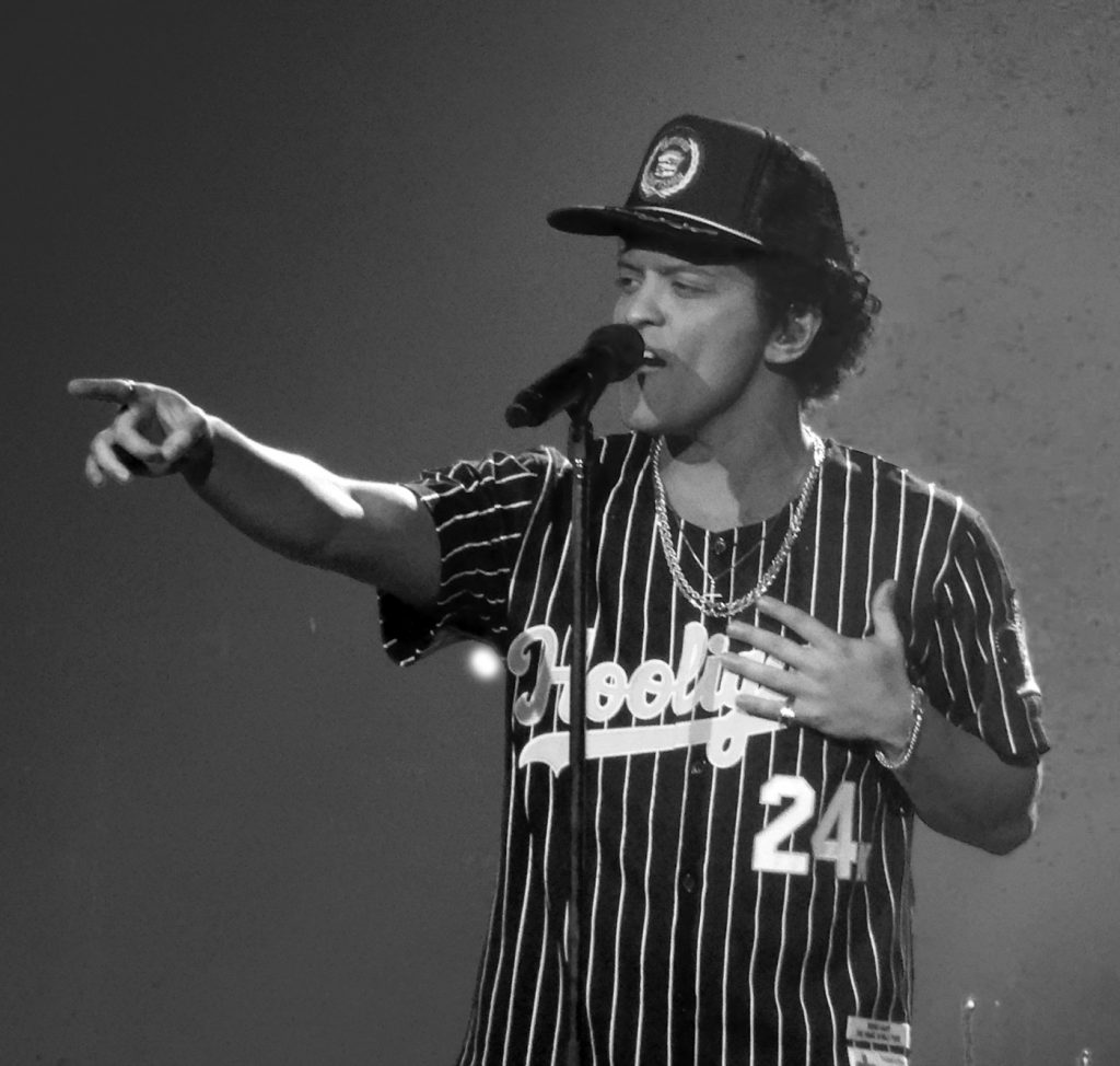 When it comes to pop music, black is still cooler, even today. Bruno Mars