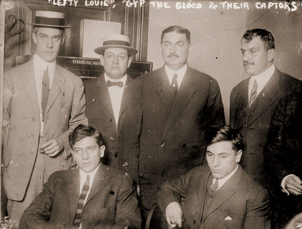 """Lefty Louie"" Rosenberg and ""Gyp the Blood"" Horowitz (seated, left to right) with others implicated in the murder of Herman Rosenthal, proprietor of an alleged casino in New York City"