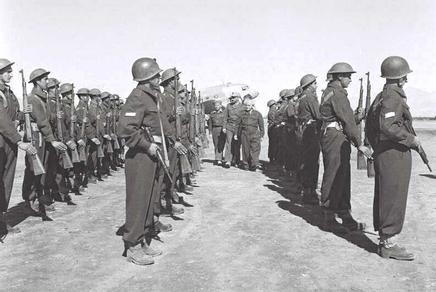 Reviewing an honor guard with the chief of staff, 1949