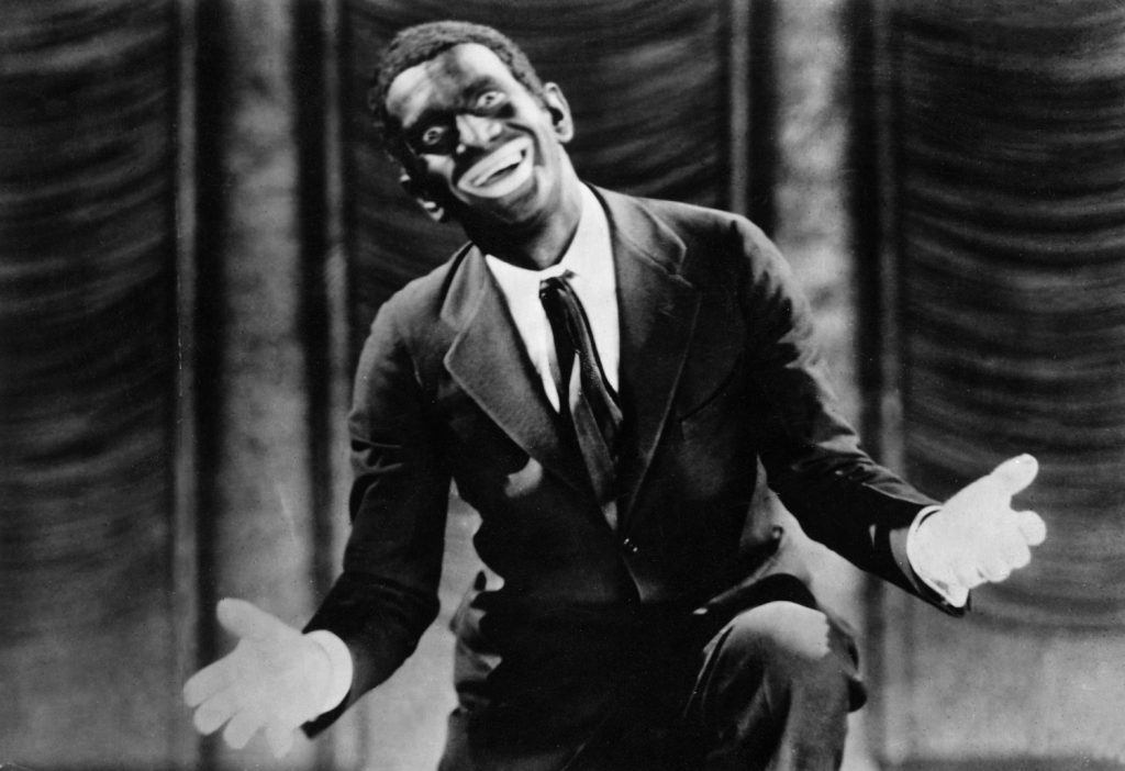 In The Jazz Singer, Al Jolson starred as a cantor's son who dreamed of a show business career. Jolson, blacked, on stage