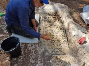cleaning the mosaic inscription