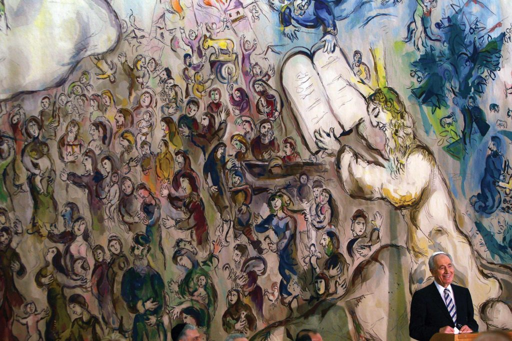 Among Chagall's most important works are three giant tapestries depicting scenes from Jewish history, which he created for the state hall of Israel's parliament building. Shimon Peres at his inauguration as president of Israel in 2007, speaking in the Knesset's Chagall State Hall, against the background of one of the artist's tapestries