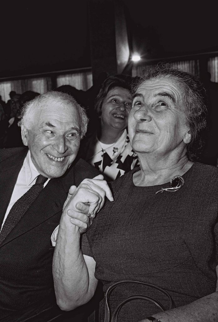 Chagall grasps Premier Golda Meir's hand at the dedication of the Chagall State Hall, summer 1969