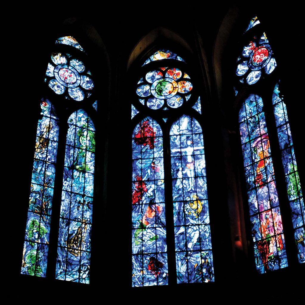 Chagall's richly colored stained glass windows grace Christian as well as Jewish settings around the world. These windows in the Reims Cathedral, France, were made in 1974
