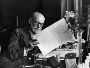 Freud reviewing the manuscript of Moses and Monotheism, his next-to-last work, in London in 1938. Returning to the subject of religion, which he'd examined much earlier in his career, Freud identifies the faith of Moses as none other than the monotheistic revolution of Pharaoh Akhnaten, then suggests that rebellious Jews killed their leader and created Judaism out of guilt