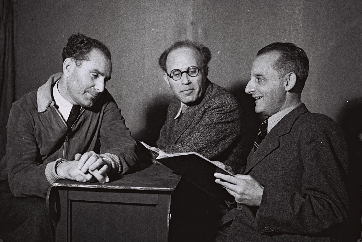 Max Brod, Kafka's close friend and fervent Zionist, escaped from Czechoslovakia on the last train before the country's annexation by Nazi Germany in 1939. Making his way to Palestine, he joined the Habima Theater but wrote and published in German until his death in 1968. Brod (right) with Habima members Baruch Chemerinski and Zvi Friedland, 1942