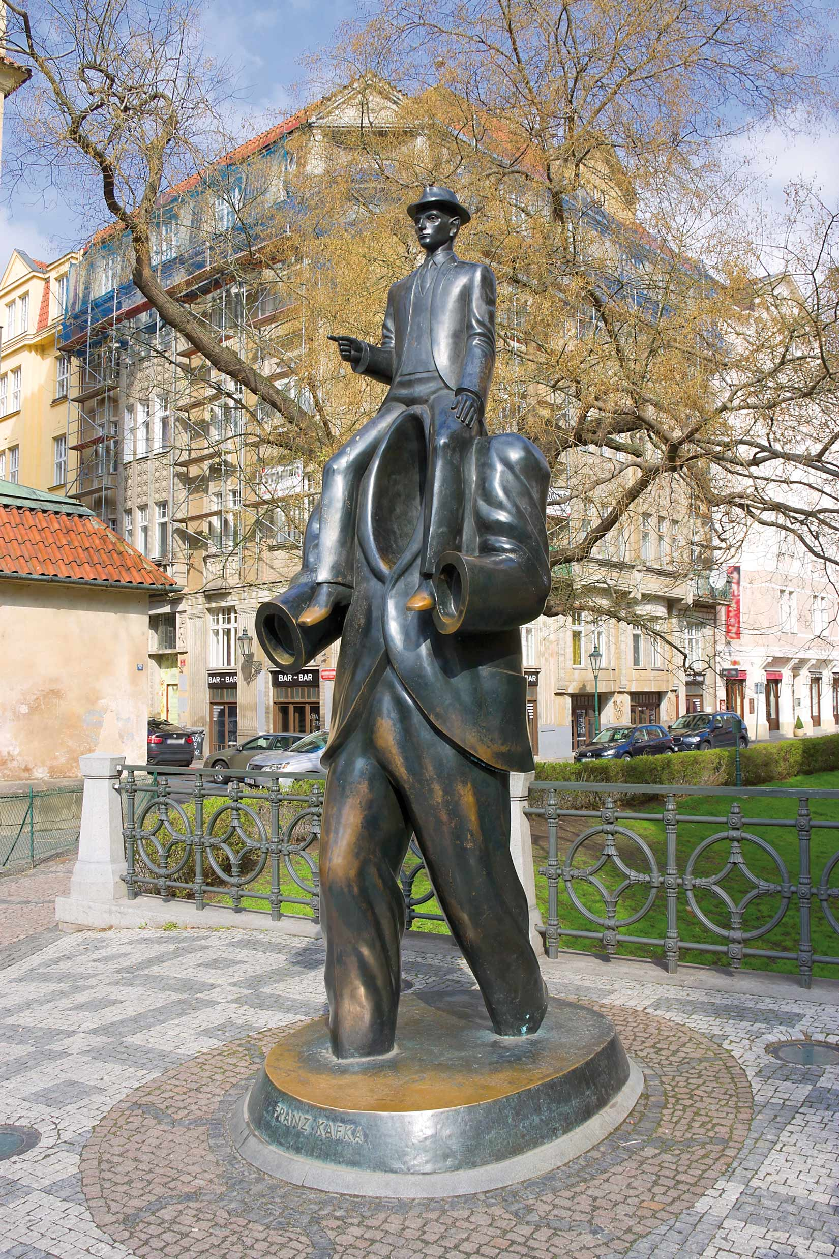 "Today Kafka has become an emblem of Prague, commemorated throughout the city. Guides offer tours of ""Kafka's Prague,"" in which this bronze statue by Jaroslav Rona – based on Kafka's Description of a Struggle – is a highlight. Its location near Prague's Spanish synagogue is also the area where Kafka lived most of his life"