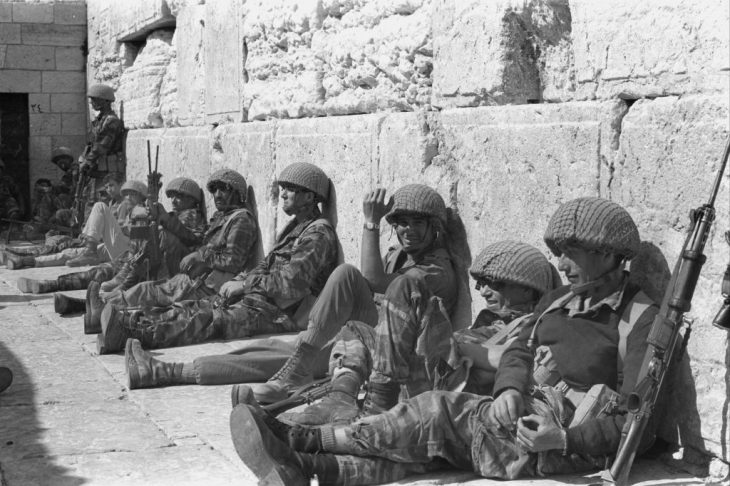 Paratroopers lean against the Western Wall just after its liberation