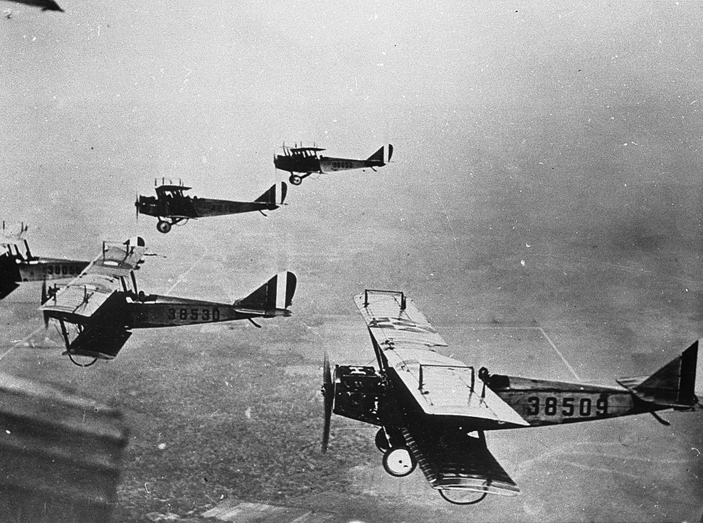 The gradual development of the internal combustion engine in the 19th century made the war's new heavy weaponry – the tank and the airplane – possible. Above: American JN-40 planes; below: a British tank