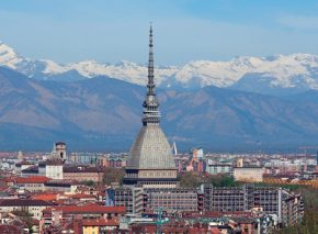 Turin, an Italian city in the foothills of the Alps. The soaring spire dwarfing the church to its left belongs to the Mole Antonelliana, originally designed as a synagogue