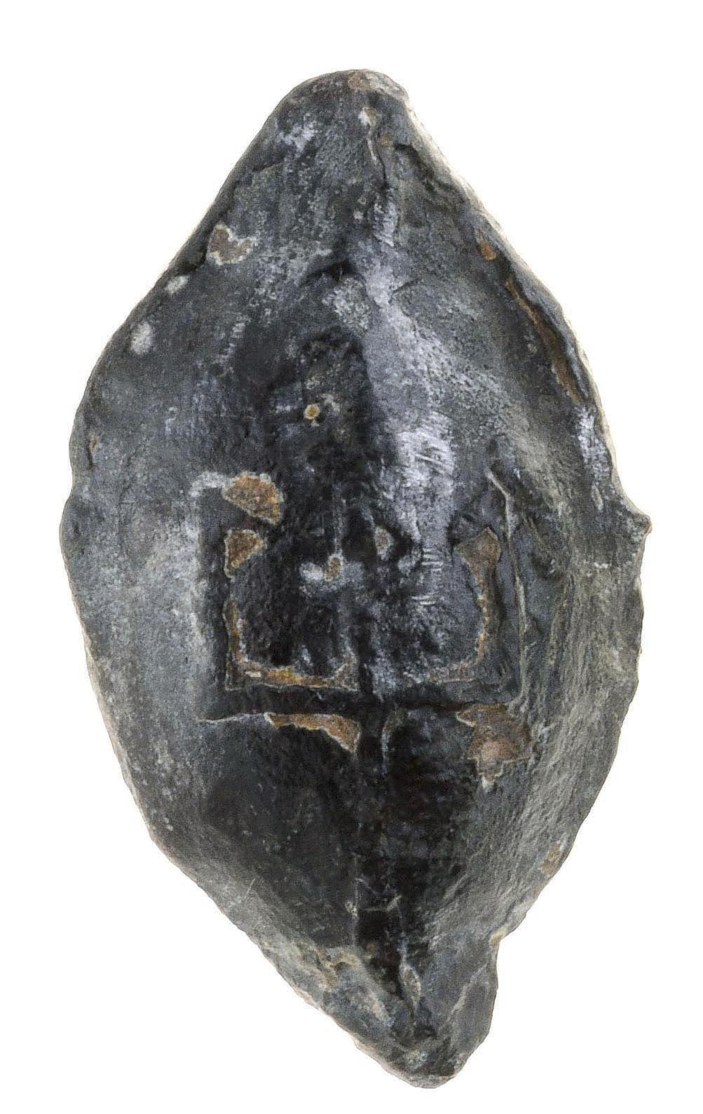 This slingshot marked with a Seleucid symbol was discovered not far from the Akra and was apparently shot from within its walls