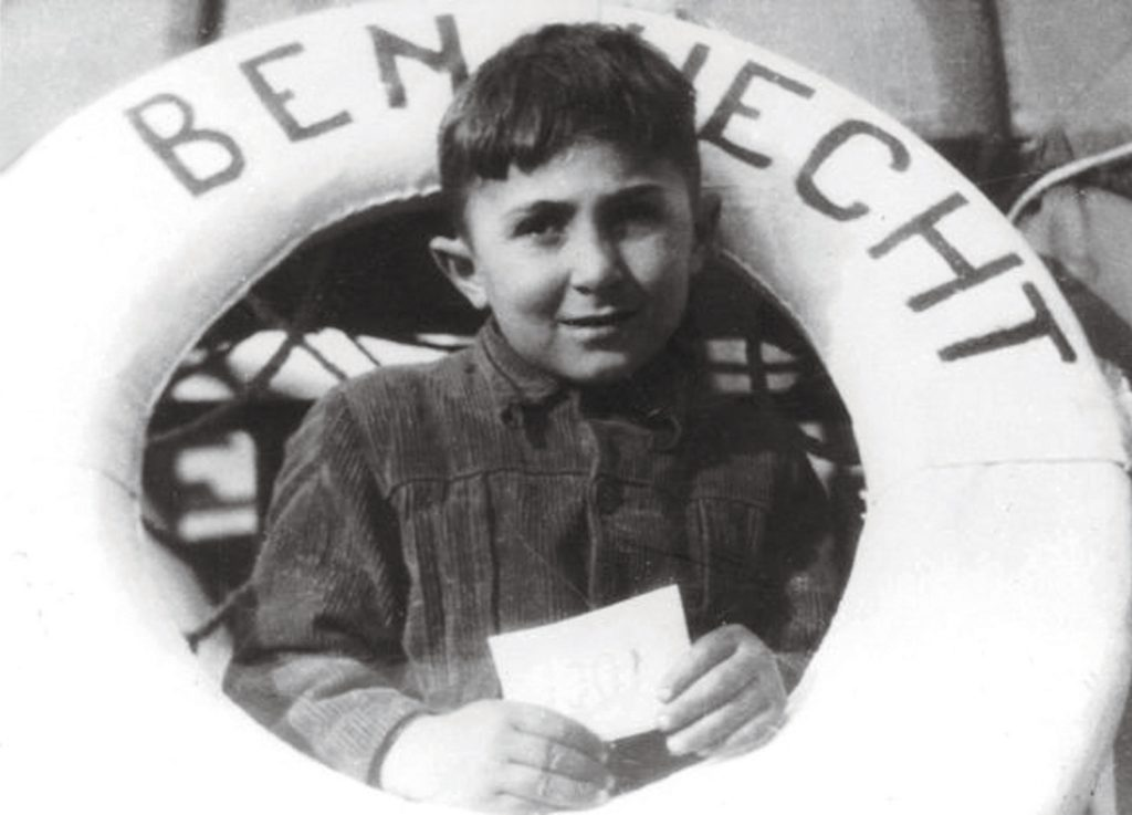 The youngest refugee aboard the SS Ben Hecht peers through a life preserver. The Bergson Group published such images widely, raising awareness of Jewish DPs