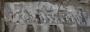 The victories of Darius I are depicted on a monument in Behistun, Iran. This section shows Darius, at center, facing his captives. The inscription proclaims Ahura Mazda as the deity who granted Darius his kingdom