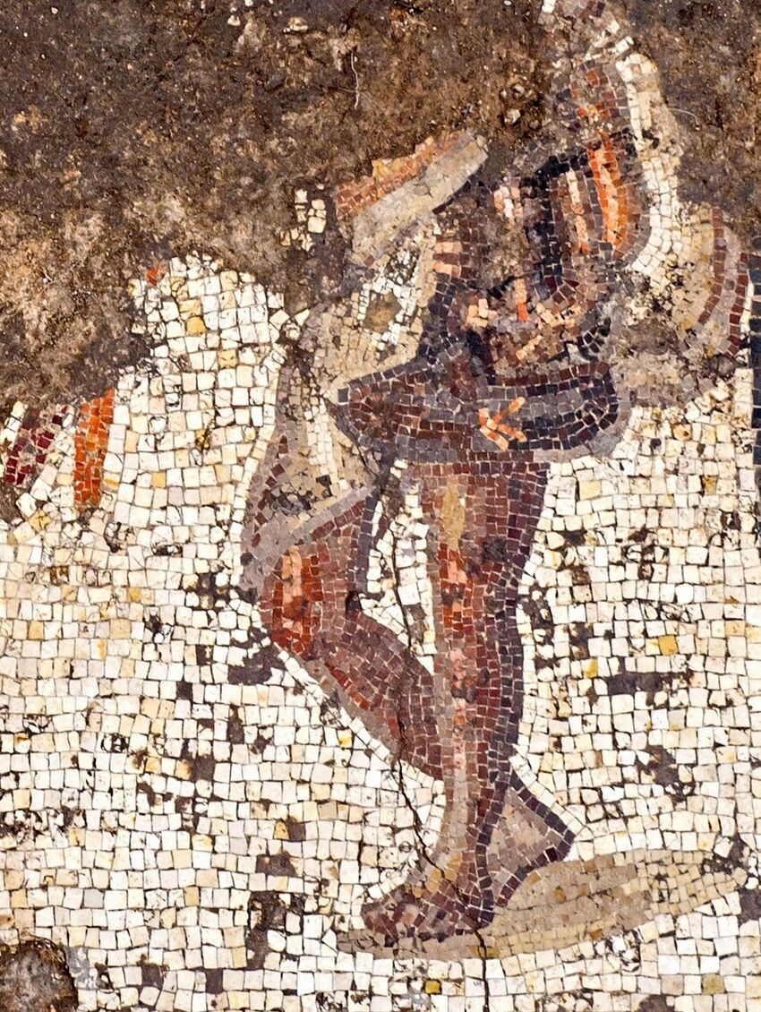 Figure in a short toga, one of three grouped together in the mosaic