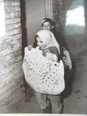 Larger than life. Girl with matza in Iran, circa 1970