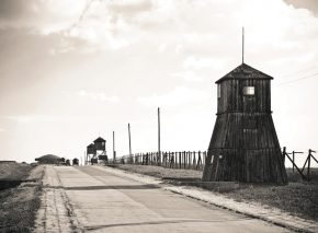 The horrors of camp life presented spiritual leaders with unprecedented challenges. Watchtowers guarding the perimeter fence of a concentration camp