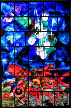 "Part of the Ardon windows at the national library, Jerusalem, illustrating the verse ""and they shall beat their swords into plowshares, and their spears into pruninghooks: nation shall not lift up sword against nation, neither shall they learn war any more."" (Isaiah 2:4)"