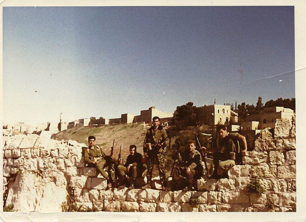 Armed Nahal soldiers stand guard above Ben Hinom Valley, beneath the Old City walls