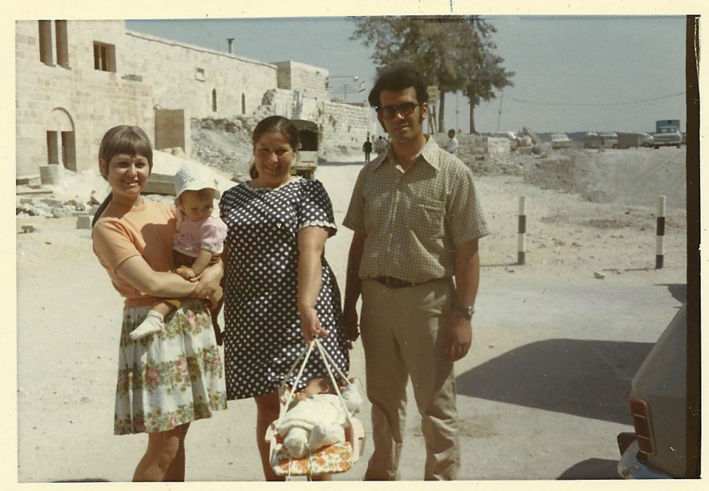 Afternoon stroll. Ganat members walking with their children in the newly rebuilt quarter. Yossi and Mira Eliav with their eldest son, and Rachel Mendelssohn with her daughter