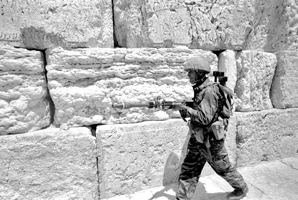 Paratrooper with antitank projectile by the newly liberated Western Wall