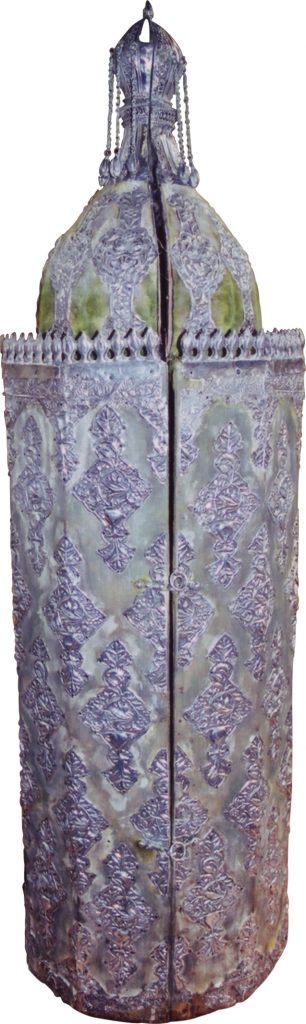 The inscription adorning the crown of the Sephardic Torah casket (wood covered with silver-inlaid velvet) states that the scroll was written in 1868 (5628)