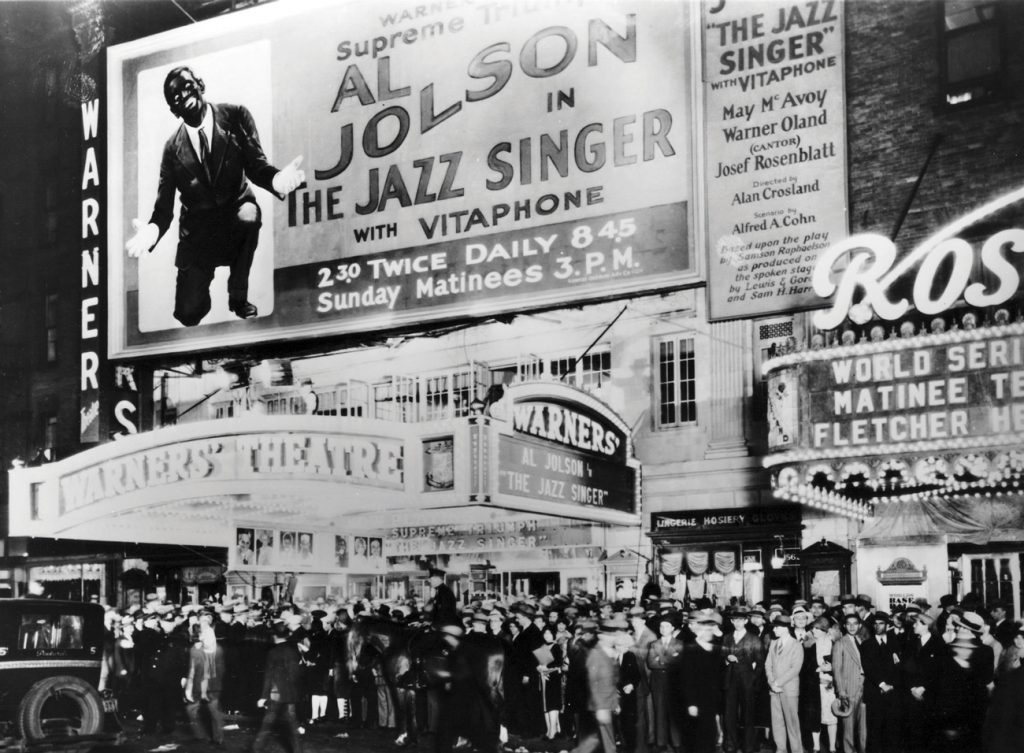 In addition to the film's success, the soundtrack of The Jazz Singer became a blockbuster in its own right. Crowds gather outside Warner Brothers' theater for the film's opening, October 6, 1927