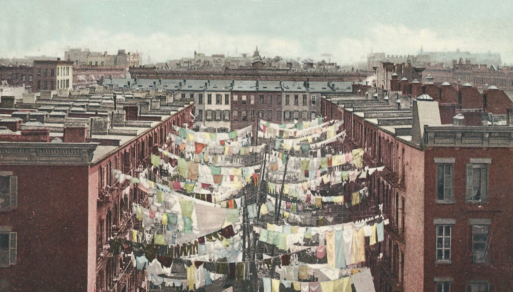 Tenement yard in the heart of New York, 1910. New immigrants and underprivileged transplants from other parts of the U.S. have transformed once Jewish neighborhoods into crime-ridden areas. Only recently have housing prices begun rising due to overcrowding elsewhere in the city