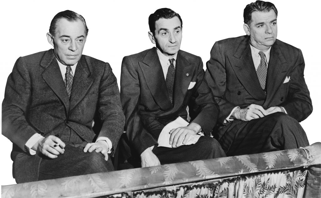Richard Rodgers, Irving Berlin, and Oscar Hammerstein II watch hopefuls audition on the stage of the St. James Theater, New York, 1948