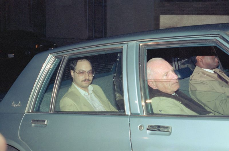 (Original Caption) Washington, DC.: Alleged spy Jonathan Pollard sits in the back of a government vehicle after appearing in U. S. District Court. Pollard and his wife, Anne Henderson-Pollard were ordered held without bail.