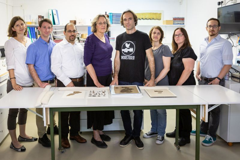 Tel Aviv University and Israel Antiquities Authority researchers with scroll fragments
