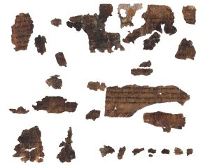 The greatest challenge lay in piecing together tiny fragments of parchment into a unified text.Scroll fragments from the famous Qumran Isaiah scroll